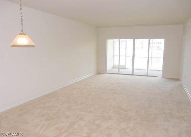 7826 Great Heron Way #104, Naples, FL 34104 (MLS #220003532) :: Clausen Properties, Inc.