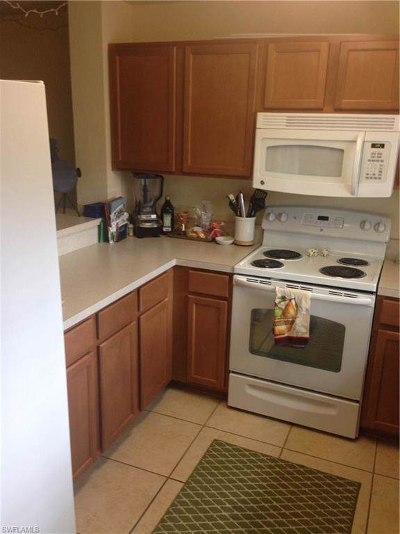7846 Regal Heron Cir #103, Naples, FL 34104 (MLS #220006443) :: Clausen Properties, Inc.
