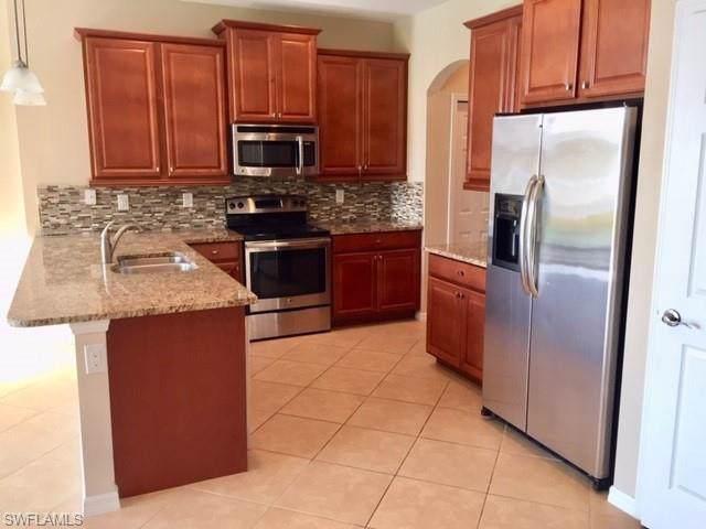 14762 Sutherland Ave #413, Naples, FL 34119 (MLS #219068003) :: Clausen Properties, Inc.
