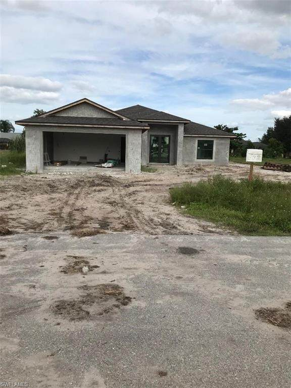 649 Carrillon Ave S, Lehigh Acres, FL 33974 (#220038456) :: The Dellatorè Real Estate Group