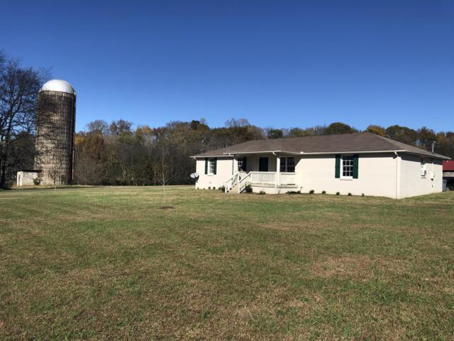 1400 Harris Hollow Rd, Charlotte, TN 37036 (MLS #1988170) :: The Milam Group at Fridrich & Clark Realty
