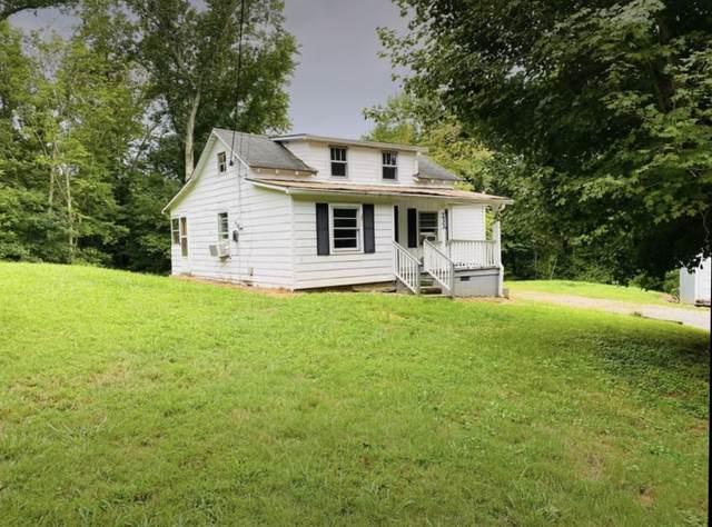 233 Antioch Rd, Bumpus Mills, TN 37028 (MLS #RTC2196799) :: John Jones Real Estate LLC