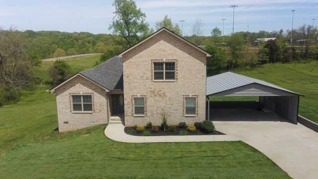 1247 Rich Ellen Dr, Palmyra, TN 37142 (MLS #RTC2248572) :: Village Real Estate