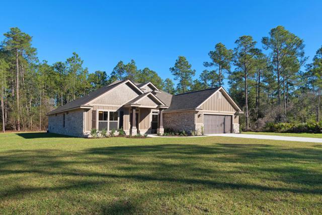 7324 E E Bay Boulevard, Navarre, FL 32566 (MLS #811944) :: ResortQuest Real Estate