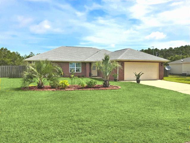 8642 Estrada Street, Navarre, FL 32566 (MLS #825563) :: ResortQuest Real Estate