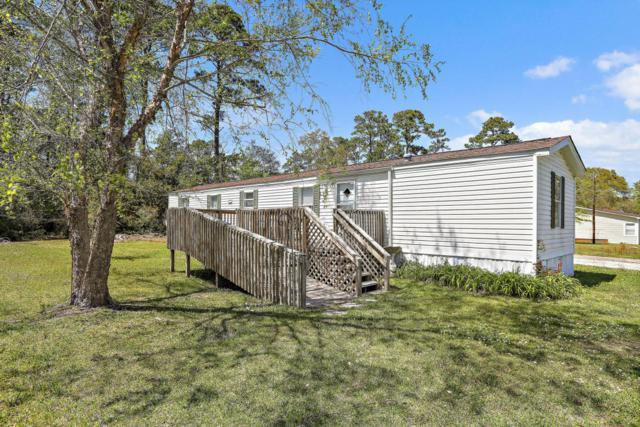 235 NE 65th Street, Oak Island, NC 28465 (MLS #100111600) :: Harrison Dorn Realty