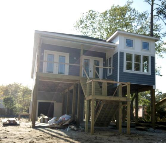 329 NE 58th Street, Oak Island, NC 28465 (MLS #100111801) :: Harrison Dorn Realty