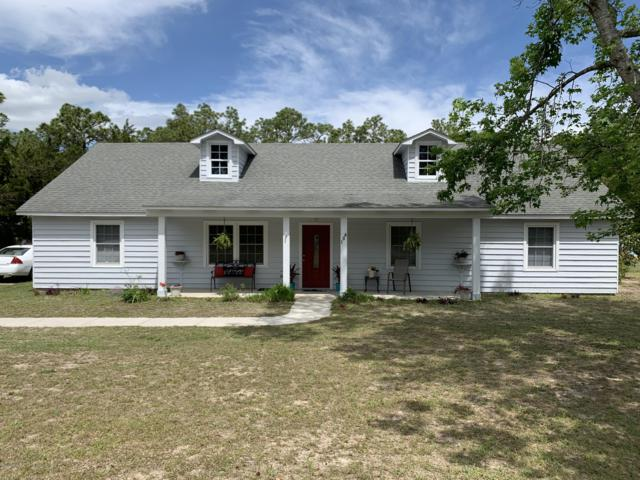 106 Grand Champion Road, Wilmington, NC 28412 (MLS #100161409) :: Vance Young and Associates
