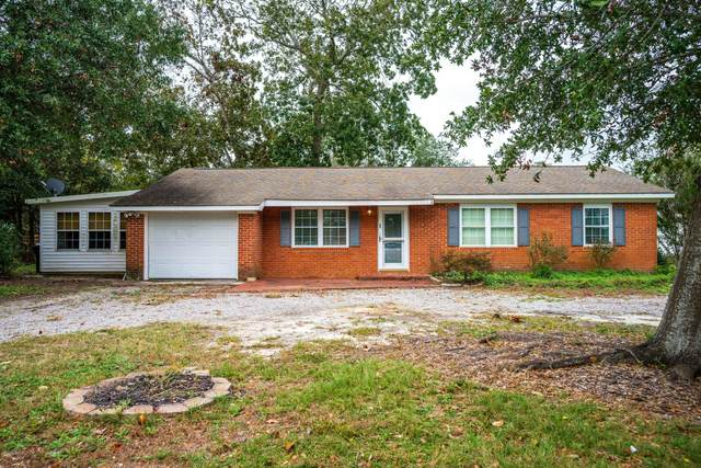 319 NE 58th Street, Oak Island, NC 28465 (MLS #100243739) :: Thirty 4 North Properties Group