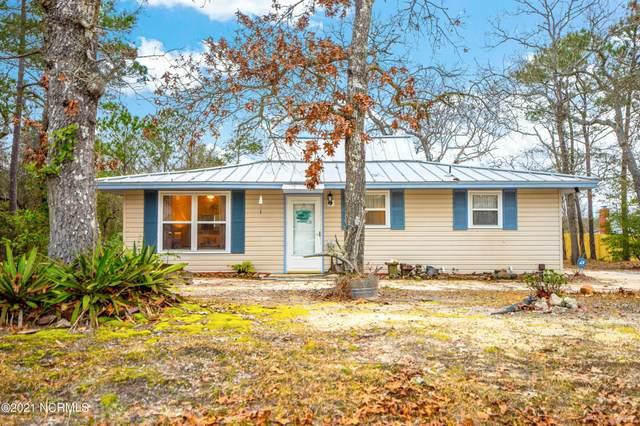 125 NW 10th Street, Oak Island, NC 28465 (MLS #100259554) :: Berkshire Hathaway HomeServices Hometown, REALTORS®