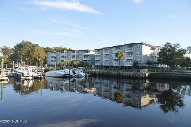 5400 E Yacht Drive Apt C5, Oak Island, NC 28465 (#100292906) :: The Tammy Register Team