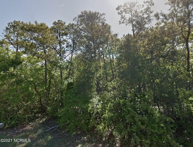 210 NE 37th Street, Oak Island, NC 28465 (MLS #100295417) :: Thirty 4 North Properties Group