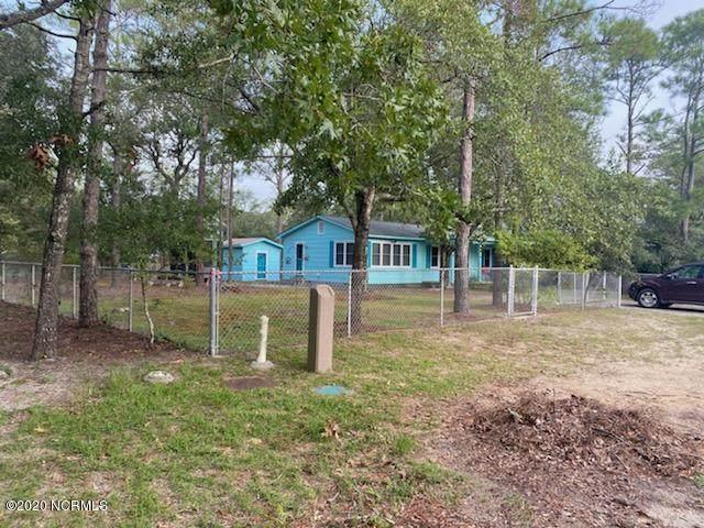 161 NW 1st Street, Oak Island, NC 28465 (MLS #100237349) :: Courtney Carter Homes