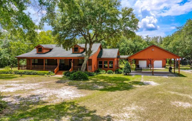 17918 Hoot Owl, Hilliard, FL 32046 (MLS #1010274) :: The Hanley Home Team