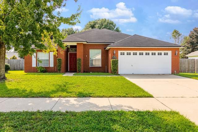 628 Martin Lakes Dr E, Jacksonville, FL 32220 (MLS #1016267) :: The Hanley Home Team