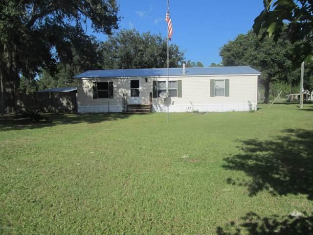 114 Janice Dr, Hollister, FL 32147 (MLS #1016353) :: The Hanley Home Team