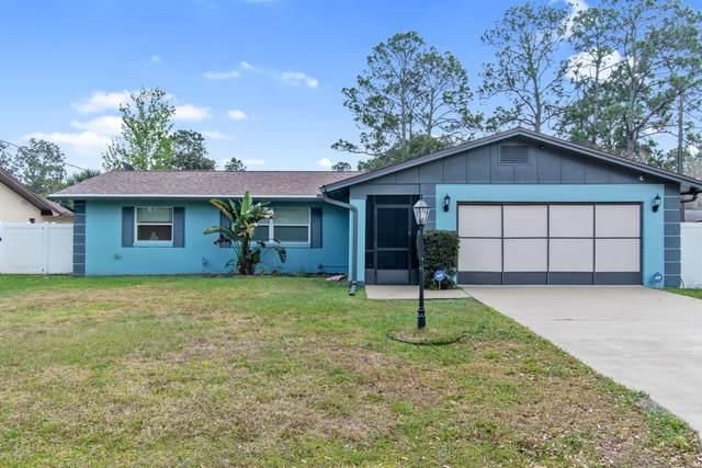 58 Fleetwood Dr, Palm Coast, FL 32137 (MLS #1042006) :: Bridge City Real Estate Co.