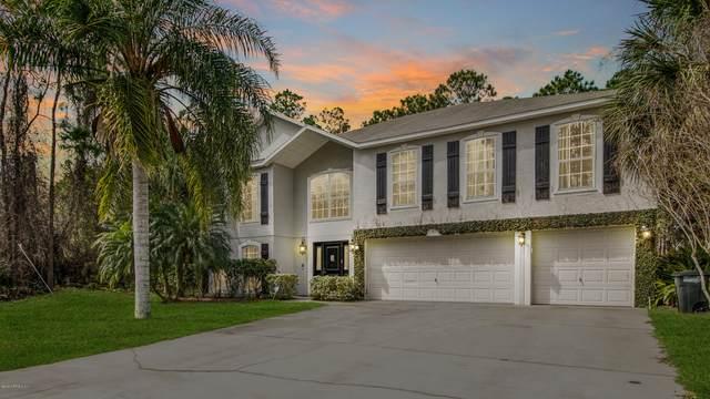 75 Putter Dr, Palm Coast, FL 32164 (MLS #1042780) :: Bridge City Real Estate Co.
