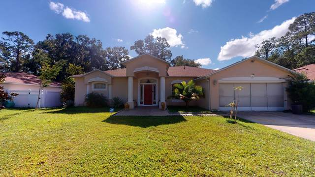 21 Rymen Ln, Palm Coast, FL 32164 (MLS #1084042) :: EXIT Real Estate Gallery