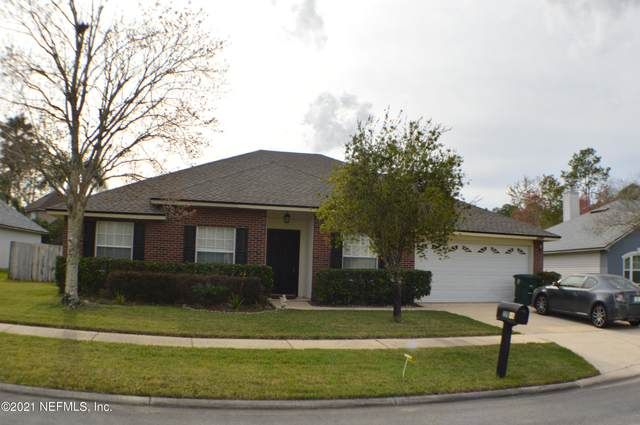 12046 London Lake Dr W, Jacksonville, FL 32258 (MLS #1097313) :: The Impact Group with Momentum Realty