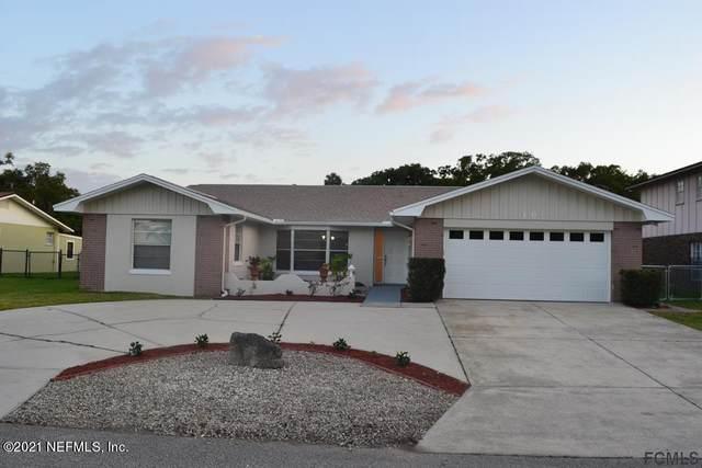10 Felicia Ct, Palm Coast, FL 32137 (MLS #1112286) :: Bridge City Real Estate Co.