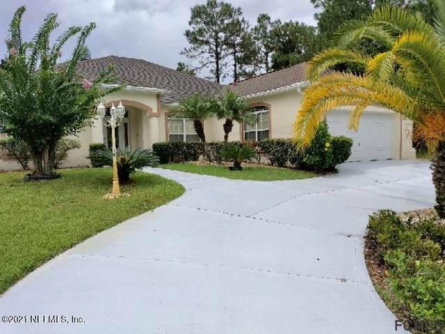 9 Wood Crest Ln, Palm Coast, FL 32164 (MLS #1128687) :: EXIT 1 Stop Realty
