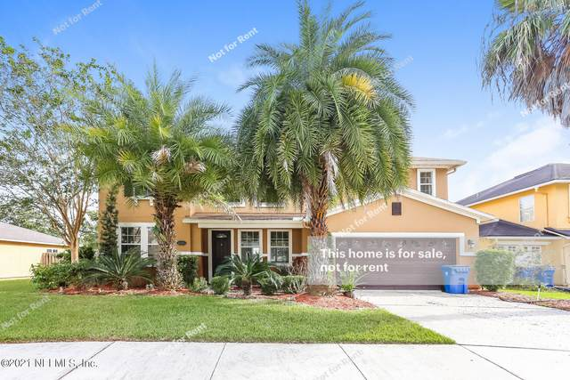 12317 Deersong Dr, Jacksonville, FL 32218 (MLS #1131013) :: The Collective at Momentum Realty