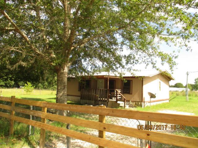 10287 SW 113TH Ave, Hampton, FL 32044 (MLS #886771) :: EXIT Real Estate Gallery