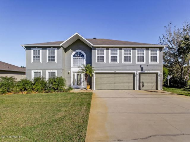220 Bird Of Paradise Dr, Palm Coast, FL 32137 (MLS #913385) :: EXIT Real Estate Gallery
