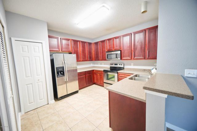 8241 Pelican Landing Way #201, Jacksonville, FL 32256 (MLS #919153) :: EXIT Real Estate Gallery