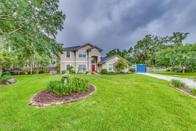 12008 Rising Oaks Dr E, Jacksonville, FL 32223 (MLS #939368) :: EXIT Real Estate Gallery