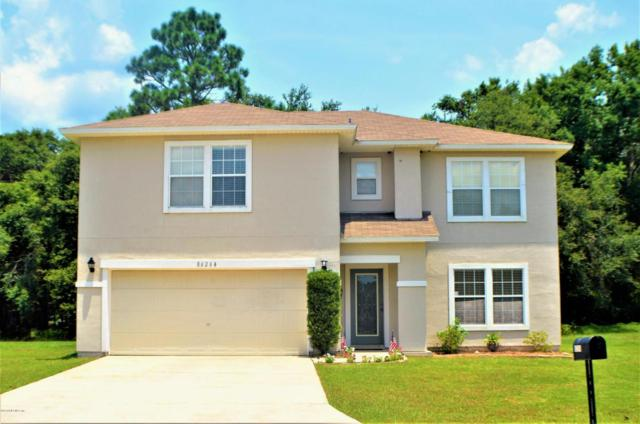 86264 Cartesian Pointe Dr, Yulee, FL 32097 (MLS #947131) :: EXIT Real Estate Gallery