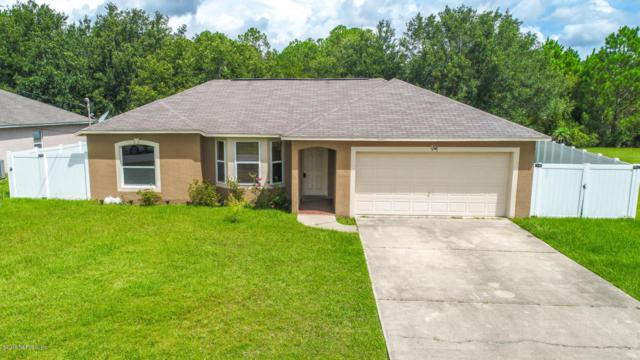 52 Langdon Dr, Palm Coast, FL 32137 (MLS #948812) :: EXIT Real Estate Gallery