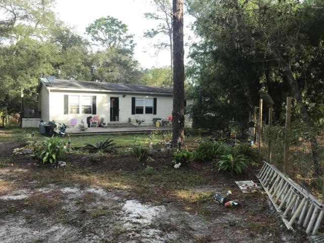 114 Sand Lake Dr, Pomona Park, FL 32181 (MLS #967724) :: Memory Hopkins Real Estate