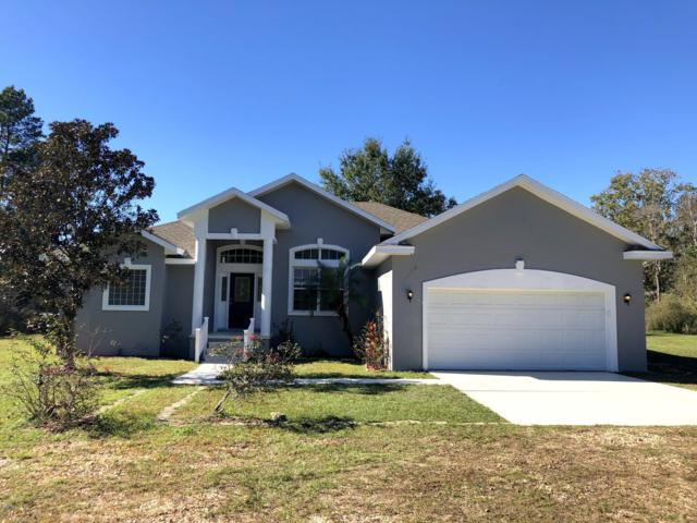 105 Woods Ln, Interlachen, FL 32148 (MLS #968936) :: Memory Hopkins Real Estate