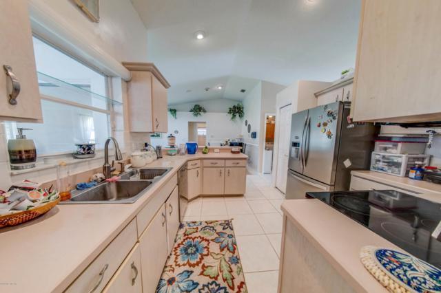 27 Woodfair Ln, Palm Coast, FL 32164 (MLS #992616) :: Berkshire Hathaway HomeServices Chaplin Williams Realty