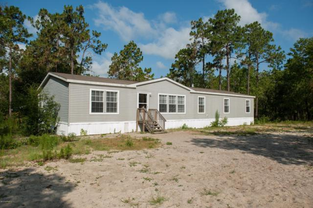 159 Hour Glass Cir, Hawthorne, FL 32640 (MLS #998357) :: The Hanley Home Team