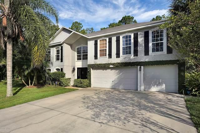 75 Putter Dr, Palm Coast, FL 32164 (MLS #1056153) :: Bridge City Real Estate Co.