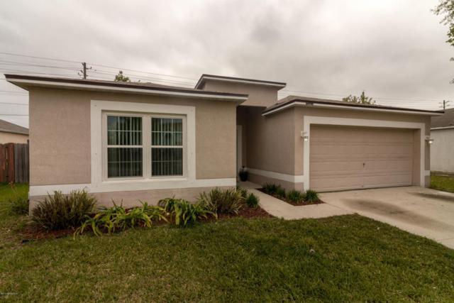 7181 Overland Park Blvd E, Jacksonville, FL 32244 (MLS #932459) :: EXIT Real Estate Gallery