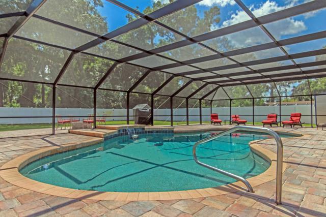2560 Spreading Oaks Ln, Jacksonville, FL 32223 (MLS #933060) :: EXIT Real Estate Gallery