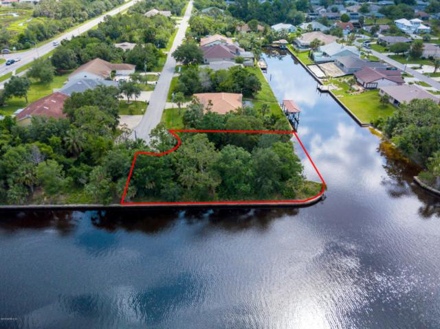 251 Coral Reef Ct N, Palm Coast, FL 32137 (MLS #936385) :: RE/MAX WaterMarke
