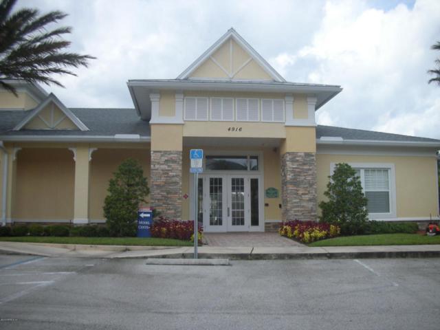 8241 Pelican Landing Way #106, Jacksonville, FL 32256 (MLS #937017) :: RE/MAX WaterMarke