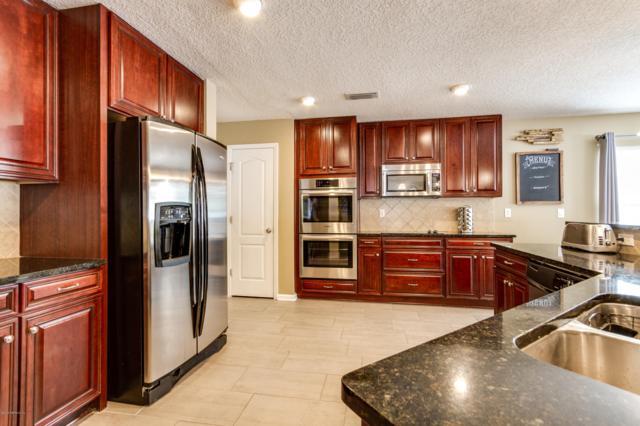 11323 Justin Oaks Dr N, Jacksonville, FL 32221 (MLS #981373) :: EXIT Real Estate Gallery