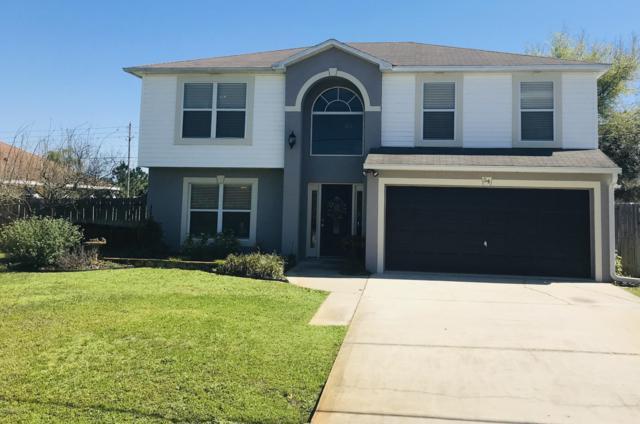 54 Louisville Dr, Palm Coast, FL 32137 (MLS #982373) :: Berkshire Hathaway HomeServices Chaplin Williams Realty