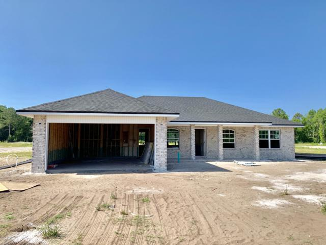 9170 Emily Lake Ct, Jacksonville, FL 32222 (MLS #986139) :: Noah Bailey Real Estate Group