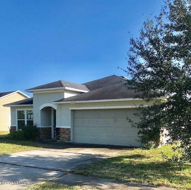 77318 Cobblestone Dr, Yulee, FL 32097 (MLS #1025386) :: The Hanley Home Team