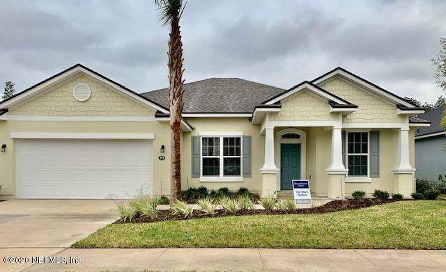 153 S Coopers Hawk Way Rd, Palm Coast, FL 32164 (MLS #1039975) :: The Hanley Home Team