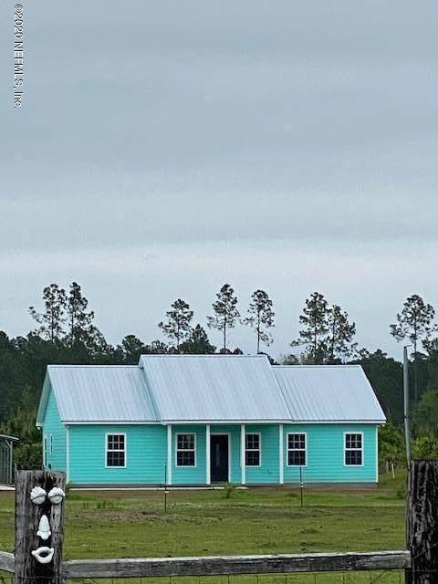 `27137 Kristie Cir N, Hilliard, FL 32046 (MLS #1055340) :: The Hanley Home Team