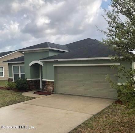 77318 Cobblestone Dr, Yulee, FL 32097 (MLS #1025386) :: Berkshire Hathaway HomeServices Chaplin Williams Realty
