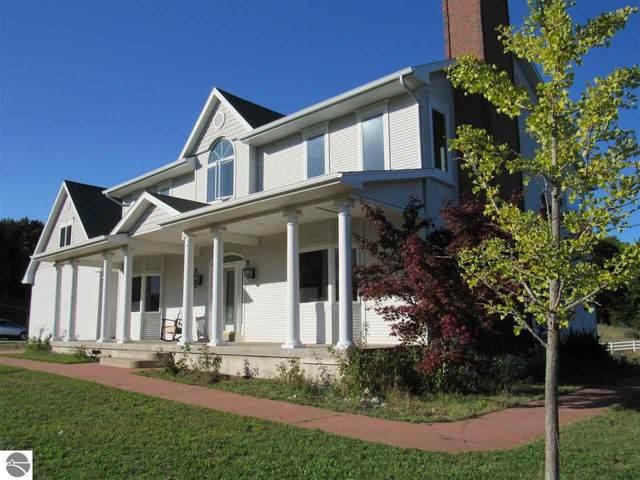 9169 E Hoxie Road, Cedar, MI 49621 (MLS #1880065) :: Brick & Corbett
